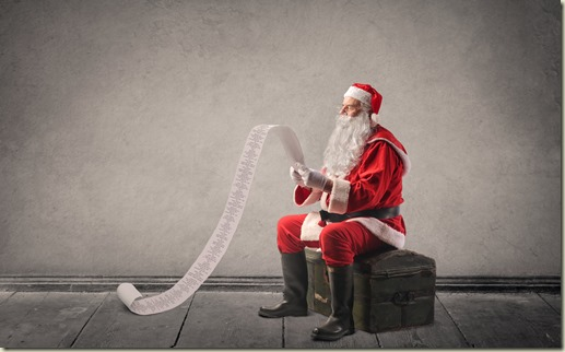 Old man dressed as santa sitting on a trunk looking at his long list